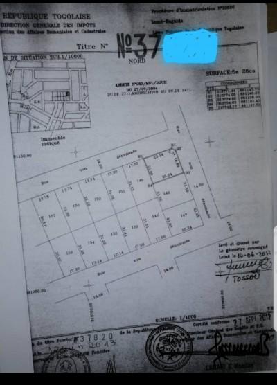 1 lot cloturé avec titre foncier sur 2 voies ( centre aéré BCAO )